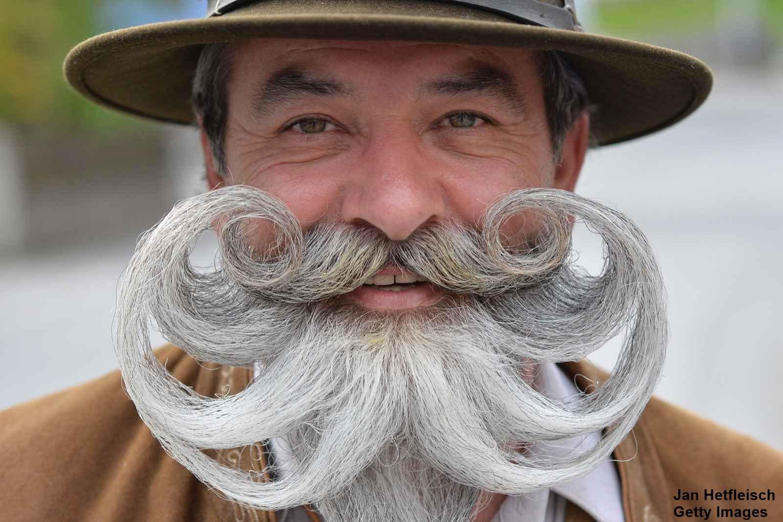 """A participant poses for photographers during the """"World Beard Championship"""" in Leogang, in the Austrian province of Salzburg, Sunday, Oct. 4, 2015. (AP Photo/Kerstin Joensson)"""