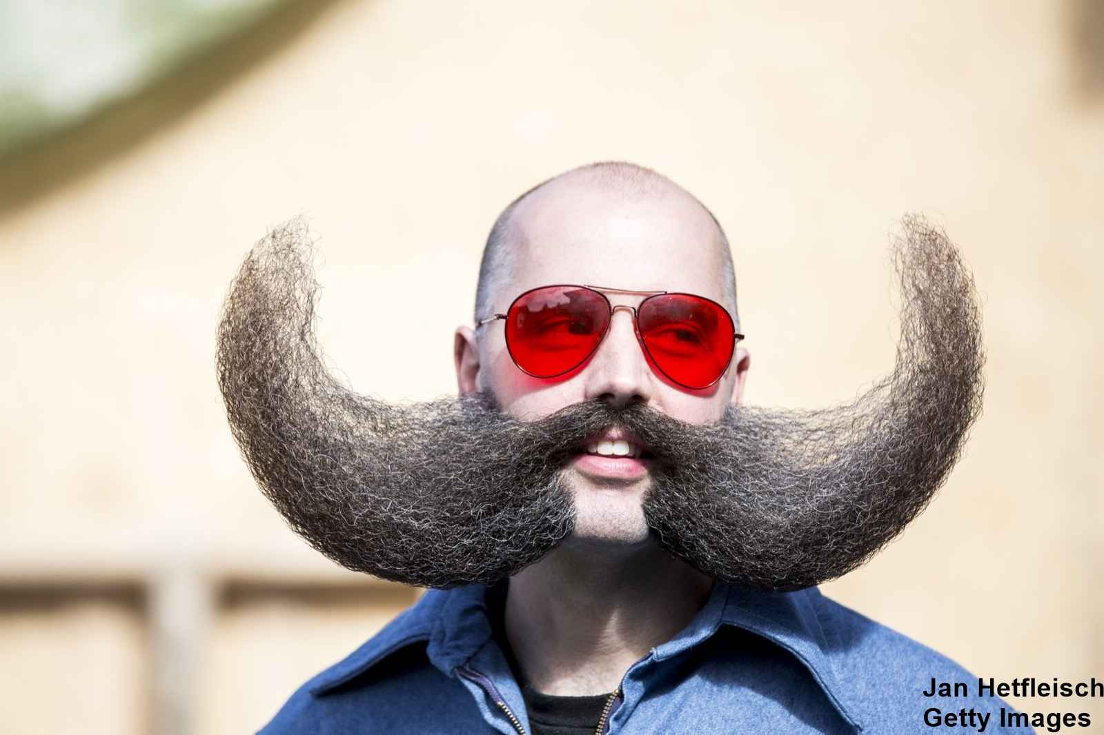 LEOGANG, AUSTRIA - OCTOBER 3: A contestant of the World Beard And Mustache Championships poses for a picture during the opening ceremony of the Championships 2015 on October 3, 2015 in Leogang, Austria. Over 300 contestants in teams from across the globe have come to compete in sixteen different categories in three groups: mustache, partial beard and full beard. The event takes place every few years at different locations worldwide. (Photo by Jan Hetfleisch/Getty Images)